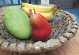 Fruit in woven bowl